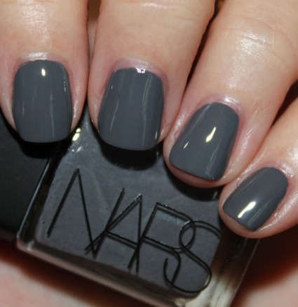 Storm Bird by NARS is a dark smoky grey creme. The formula is very creamy and opaque. Just two coats covers really nicely, and it's shiny to boot! I love how dark this shade is and weirdly enough, I do not think I have a dupe for this shade in my collection! I think the closest I have to it is Ciate Vintage, but this seems to have more blue undertones. (Vampyvarnish.com)
