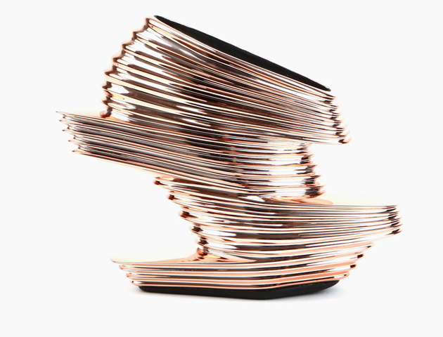 Launched in 2013 as part of a limited edition haute couture collection, designed by architect Zaha Hadid